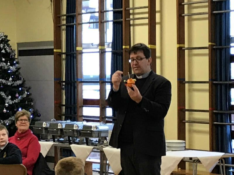 Archdeacon Forster explains the meaning of the Christingle